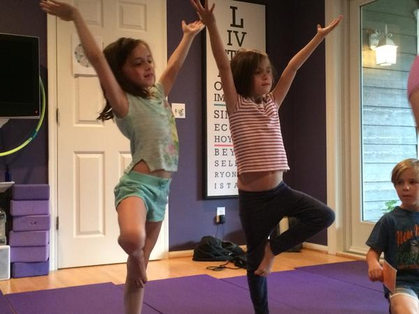 The enthusiasm  of young students at a Children's Yoga Kansas City class reflects a proactive attitude toward health that's common in Johnson County.