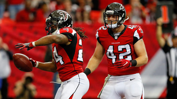 #24 Devonta Freeman celebrates a touchdown with Patrick DiMarco #42 on Nov. 27, 2016 in Atlanta, Georgia. DiMarco is OK with having a backing role on the team.