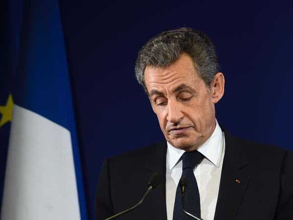 Former French President Nicolas Sarkozy delivers a concession speech after he was knocked out in first-round presidential primary voting in November 2016. He is accused of violating France's campaign finance laws.