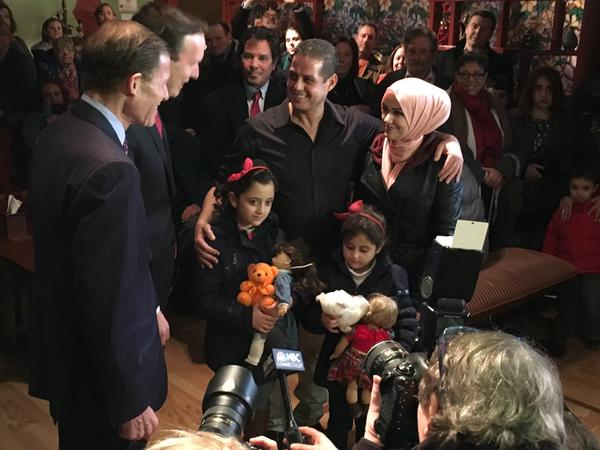 U.S. Senators Richard Blumenthal and Chris Murphy, both Democrats from Connecticut, greet the newly reunited Kassar family at Olive Tree restaurant in Milford, Conn., on Friday.