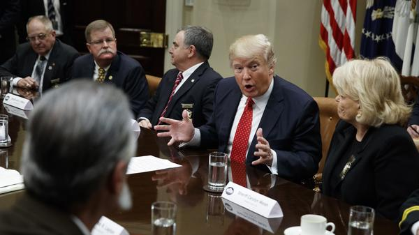 President Trump speaks during a meeting with county sheriffs at the White House on Tuesday.