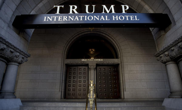 President Trump has removed his name from the lease of the Trump International Hotel in Washington, D.C., but the revocable trust he has set up for its profits has not settled ethics concerns.