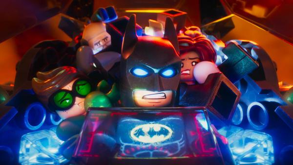 Robin (Michael Cera), Alfred Pennyworth (Ralph Fiennes), Batman (Will Arnett), Batgirl (Rosario Dawson) in <em>The LEGO Batman Movie</em>.