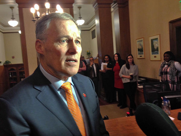Gov. Jay Inslee speaks in his office foyer Thursday afternoon in reaction to the 9th Circuit Court ruling on Preisdent Trump's travel ban.