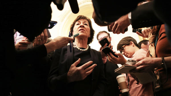 Maine Sen. Susan Collins speaks to the media after voting against Betsy DeVos as education secretary on Capitol Hill on Feb. 7.