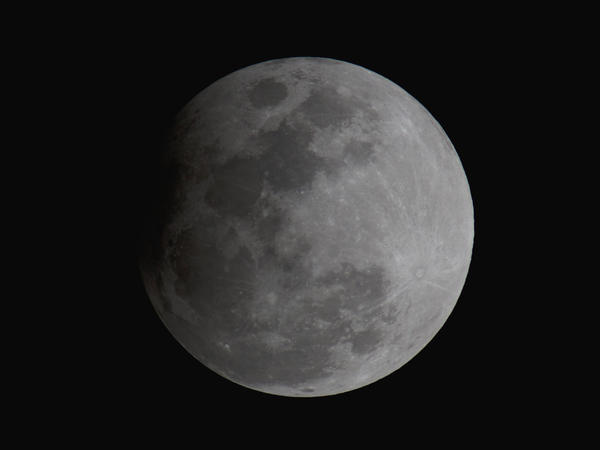 "The ""Snow Moon""during the peak of the penumbral lunar eclipse on Friday night, as seen from Orlando, Fla."