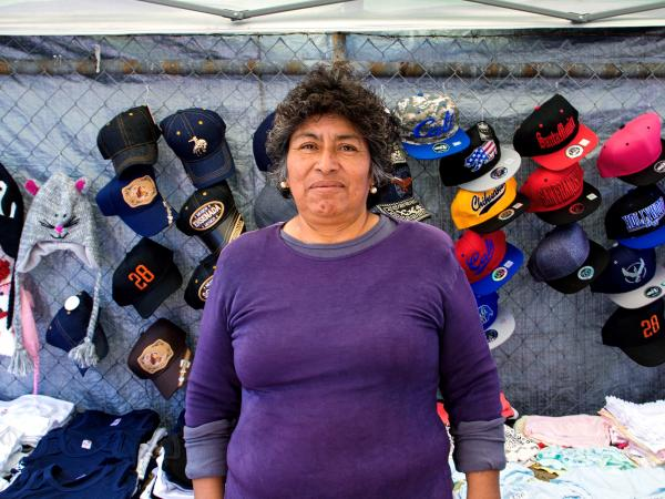 Merced is a vendor in the piñata district. She is worried that the city council's plan for a legal permitting system for sidewalk vendors, as proposed, will severely limit how many vendors can be on a given sidewalk, leaving many without a place to do business.