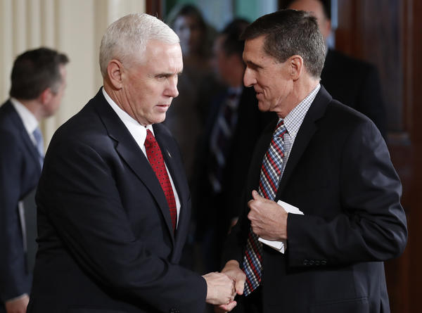 Vice President Pence (left) shakes hands with former national security adviser Michael Flynn before the start of a joint press conference between President Trump and Japanese Prime Minister Shinzo Abe on Friday. Flynn resigned Monday night after multiple reports were published noting he had misled the vice president and others in the administration.
