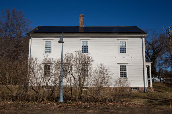 The Eli Whitney Boarding House in Hamden, Connecticut. Solar panels are installed on the south-facing side of the roof.