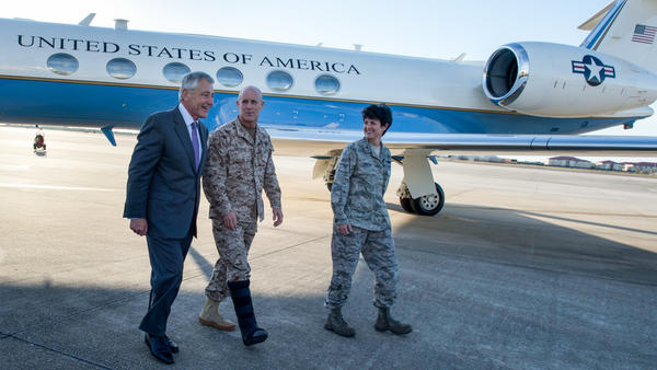 U.S. Secretary of Defense Chuck Hagel (left) walks with Vice Adm. Robert Harward (center), the deputy commander of U.S. Central Command, and Col. Kelly Martin, the vice commander of 6th Air Mobility Wing, after landing at MacDill Air Force Base in Tampa, Fla., in 2013.