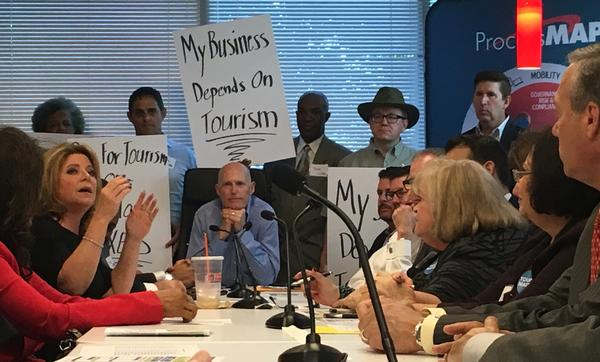 Governor Rick Scott listens to business owners and tourism leaders in Sunrise, in part of a tour he is taking around Florida, in efforts to combat proposed legislation that would abolish two state entities - Enterprise Florida and Visit Florida.