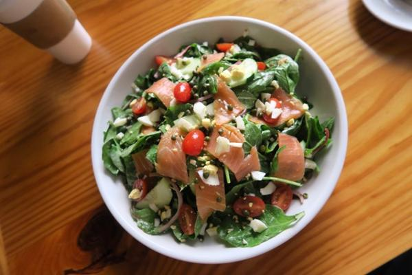 A salad of fresh greens and smoked salmon at G&O Food Co. in downtown New Orleans.