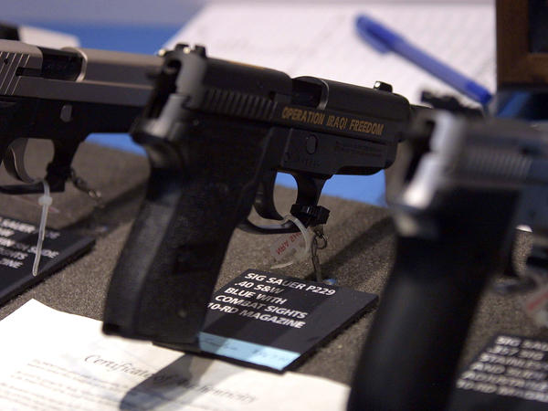 A handgun on display at the National Rifle Association's 2003 annual meeting in Orlando, Fla. A federal appeals court struck down part of a Florida law prohibiting physicians in that state from discussing guns in the home with their patients.