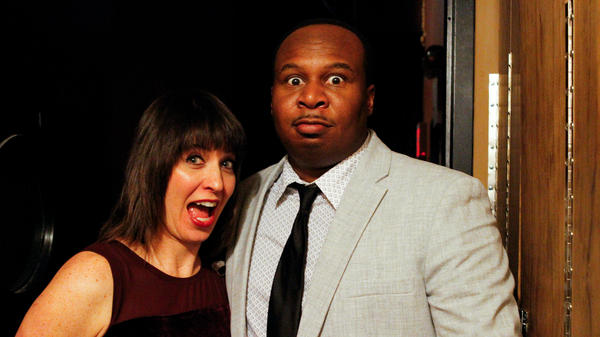 Host Ophira Eisenberg with Roy Wood Jr. on <em>Ask Me Another.</em>