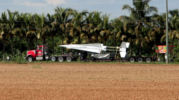 A truck transports a Nike Hercules anti-aircraft missile through Florida's Redlands.