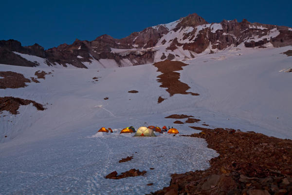 "<p>""Kamp Tenacious"" was the name given to the rocky, exposed and often uncomfortable patch of glacier at 6,400 feet in elevation that served as base camp. It had the benefit of providing excellent access to the three named glacier caves; Snow Dragon, Pure Imagination and Frozen Minotaur. Each year, teams of specialists would spend up to a week based at Kamp Tenacious to map, survey and conduct science within the unique glacier cave ecosystem. Lead explorers Brent McGregor, Eduardo ""Eddy"" Cartaya and Scott Linn made more frequent visits to keep tabs on seasonal changes to the caves.</p>"