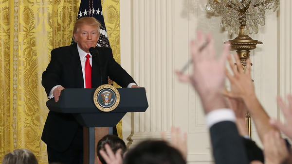 President Trump takes questions from reporters during a news conference Thursday. His supporters like it when he criticizes the media.