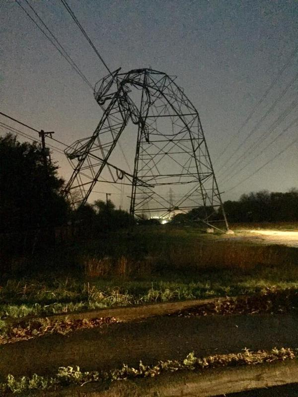 Power lines are bent and toppled by a storm near Urh Lane and Higgins Road on the Northeast Side late Sunday night bringing with it heavy rain and one confirmed tornado.
