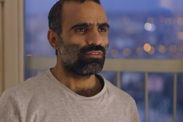 Mansoor al-Dayfi sits in his apartment in Serbia. He was resettled there after serving 14 years in Guantanamo Bay, Cuba.