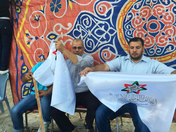 Muslim Brotherhood campaign volunteers work at an election rally in Zarqa, Jordan, in September 2016. The brotherhood's political wing fielded candidates under a coalition that included Christians and ethnic minorities. The group is now the biggest bloc in the Jordanian Parliament.