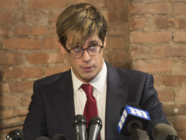 Milo Yiannopoulos speaks during a news conference Tuesday in which he announced his resignation as a senior editor with Breitbart News.
