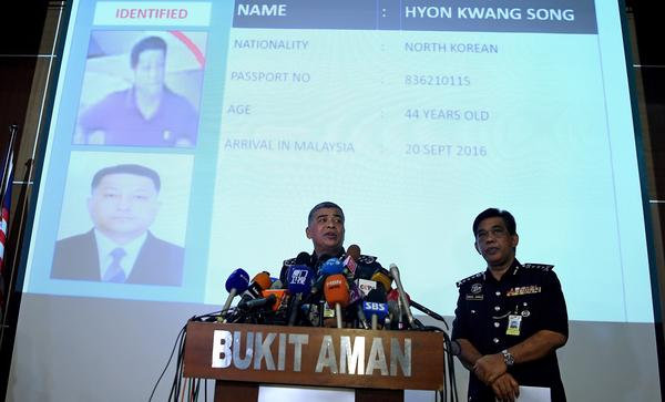 Royal Malaysian Police Chief Khalid Abu Bakar addresses journalists in front of a screen displaying the details of North Korean Embassy staffer Hyon Kwong Song, who has been identified for questioning, during a press conference at the Bukit Aman police headquarters in Kuala Lumpur.