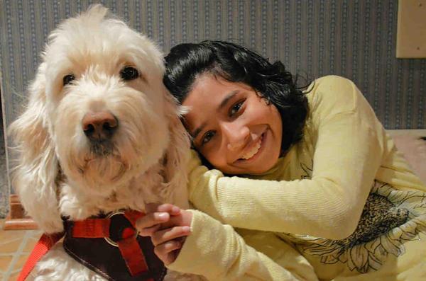 Ehlena Fry and her service dog, Wonder.