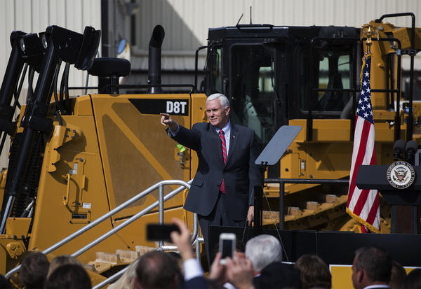 Vice President Mike Pence points into the audience after delivering remarks at Fabick Cat in Fenton, Missouri.