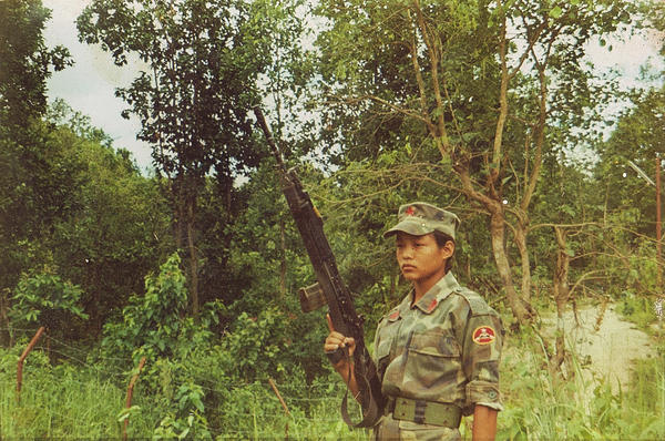 In this undated photo, Rai poses in her Maoist army uniform.