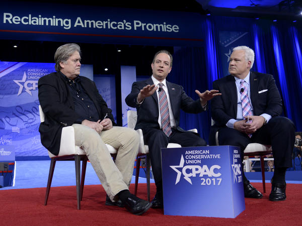 White House Chief of Staff Reince Priebus (center) speaks onstage at CPAC in National Harbor, Md., with White House adviser Steve Bannon (left) and American Conservative Union Chairman Matt Schlapp on Thursday.