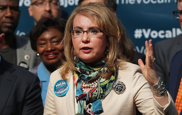 "Former Rep. Gabrielle Giffords says lawmakers should ""have some courage"" and face their constituents at town halls, despite protests."
