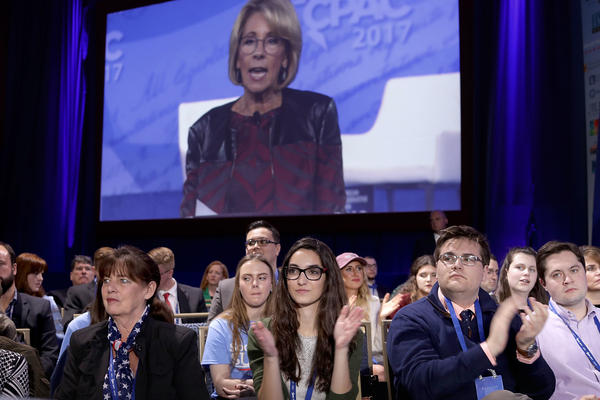 A screen projection shows U.S. Secretary of Education Betsy DeVos addressing the crowd at the Conservative Political Action Conference, or CPAC, in National Harbor, Md.
