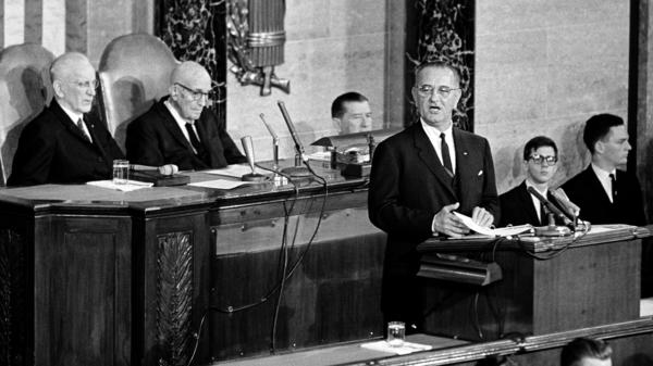 President Johnson charts a course for his administration in a speech to Congress on Nov. 27, 1963. Seated behind the new president are House Speaker John McCormack (left) and Sen. Carl Hayden.
