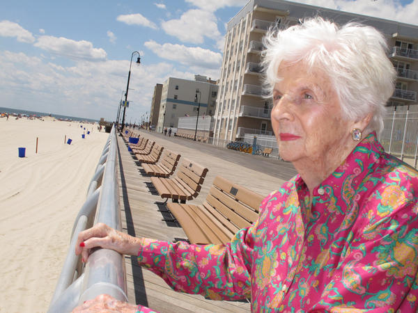 In this 2015 photograph, Lucille Horn stands on the boardwalk outside her home in Long Beach, N.Y.
