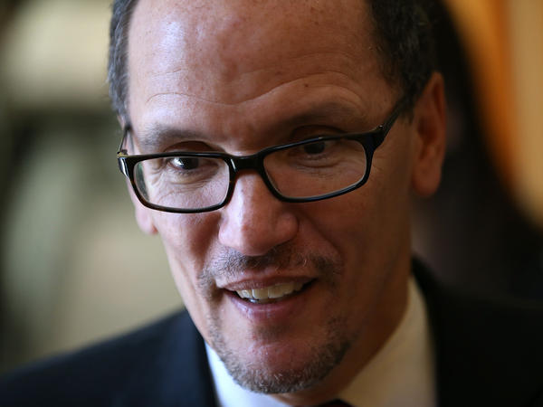 U.S. Labor Secretary Thomas Perez looks on while visiting La Cocina on January 22, 2014 in San Francisco.