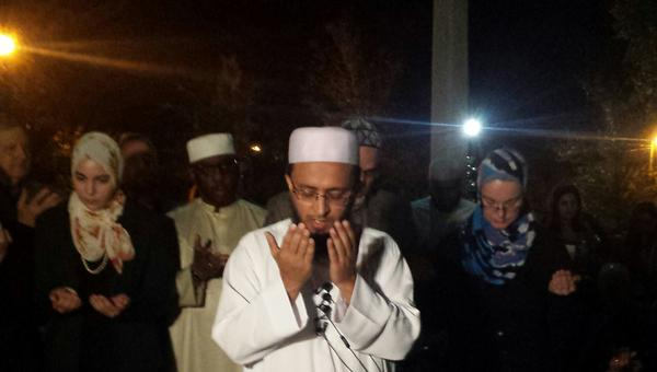 Junaid Khan offers a prayer for the interfaith gathering