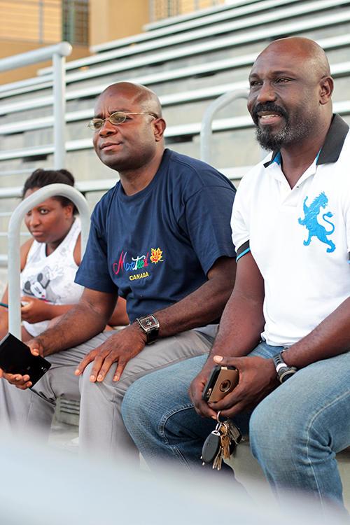 Gomez Laleau (center) coaches the boys' soccer team at Miami-Edison High and oversees the Little Haiti Football Club.