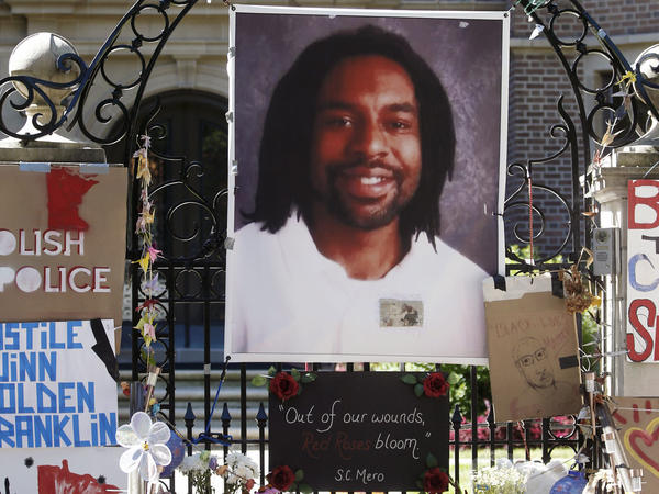 A memorial including a photo of Philando Castile is attached to the gate of the governor's residence in St. Paul, Minn., to protest the July 2016 shooting death.