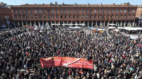 Hundreds of people gather on March 23 on the main public square in Toulouse, France, to pay homage to the seven victims of self-proclaimed al-Qaida militant Mohamed Merah.