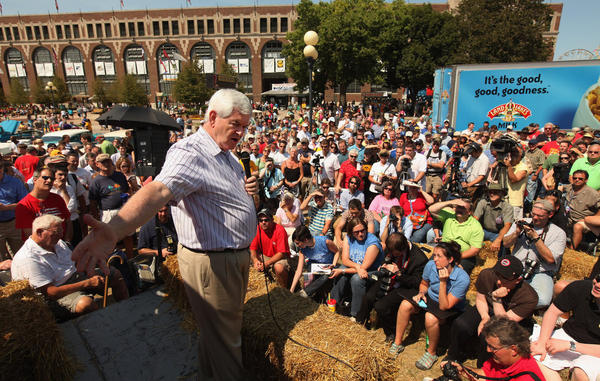 At the Iowa State Fair, Gingrich talks to voters from the <i>Des Moines Register</i>'s soapbox on Aug. 12, 2011, in Des Moines, Iowa.