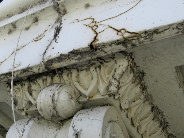 Damage caused by age and weather is visible on the Capitol dome.
