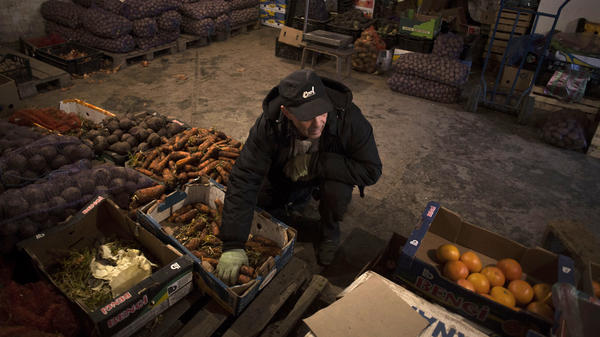 A man works in a fruit warehouse at a market in Bakhchisaray, Crimea, on March 16. One of Crimea's few strong industries has been tourism, and it is likely to be weakened by the recent turmoil in the region.