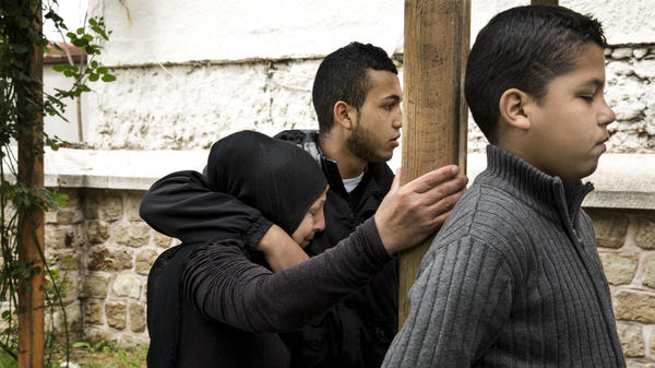 Ahmad al-Aydi (center) tries to comfort his mother, Maryam Othman, as she recounts their harrowing experience with the Bulgarian border police. Even youngest son Osama, 10, was not spared a beating, they said during an interview outside a mosque in Edirne, Turkey. The family is currently staying in a hotel and hoping to cross the border to Bulgaria again soon.