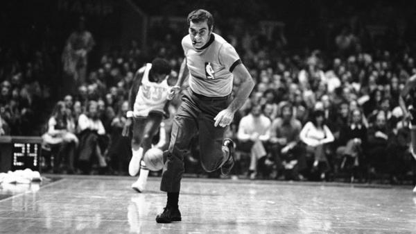 "Referee Mendy Rudolph officiates a Knicks-Pistons game in 1971. Refs often say it's best to go unnoticed, but an official who ""makes a call with vigor and elan is really a beautiful part of the game,"" says Frank Deford."