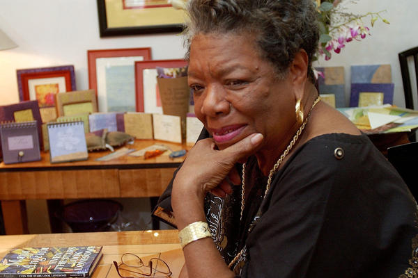 Maya Angelou answers questions during an interview in her New York apartment in 2002. Angelou died Wednesday at 86.