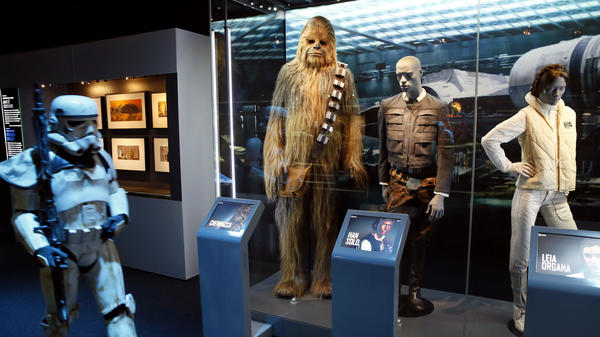 "While cities are still competing for the not yet built Lucas Cultural Arts Museum, parts of the collection are already on display. The ""Star Wars Identities"" traveling exhibition, currently at the Cite du Cinema in Saint-Denis, France, features 200 objects from George Lucas' collection — including the costumes of Chewbacca, Han Solo and Princess Leia Organa."