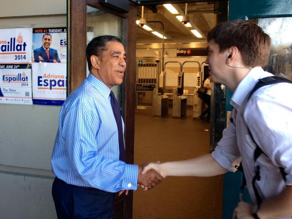 State Sen. Adriano Espaillat greets voters at a subway stop in Upper Manhattan