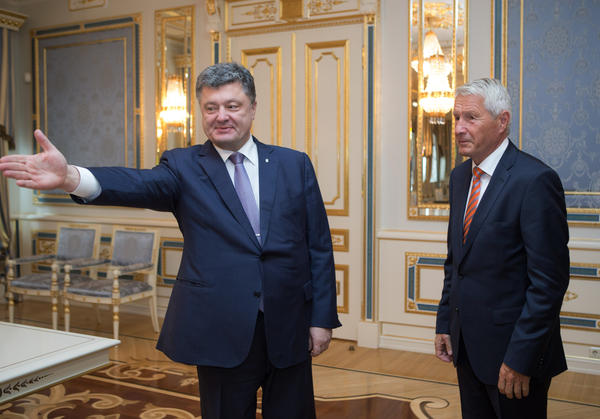 Ukrainian President Petro Poroshenko (left) welcomes Secretary General of the Council of Europe Thorbjorn Jagland during a meeting Monday.