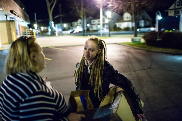 Tina Wolf (right) chats with Teri Kroll, a community overdose prevention activist, after a training event in Lindenhurst, N.Y. Kroll lost her son to an overdose in 2009, but has since revived a stranger with Narcan.