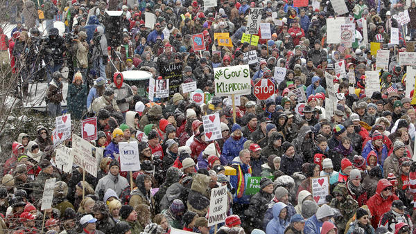 In 2011, thousands protested outside Wisconsin's Capitol building, opposing Walker's bill to eliminate collective bargaining rights for many state workers.